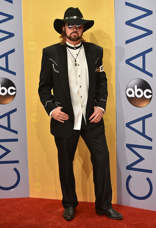 . Billy Ray Cyrus arrive at the 50th annual CMA Awards at the Bridgestone Arena on Wednesday, Nov. 2, 2016, in Nashville, Tenn. (Photo by Evan Agostini/Invision/AP)