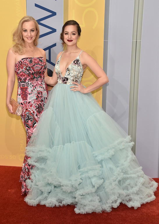 . Wendi McLendon-Covey, left, and Hayley Orrantia arrive at the 50th annual CMA Awards at the Bridgestone Arena on Wednesday, Nov. 2, 2016, in Nashville, Tenn. (Photo by Evan Agostini/Invision/AP)