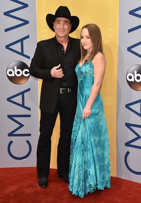 . Clint Black, left, and Lily Pearl Black arrive at the 50th annual CMA Awards at the Bridgestone Arena on Wednesday, Nov. 2, 2016, in Nashville, Tenn. (Photo by Evan Agostini/Invision/AP)