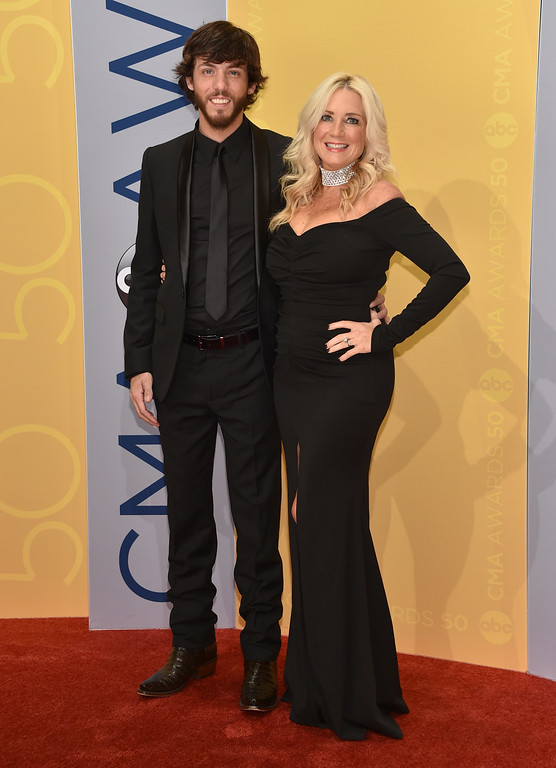 . Chris Janson, left, and Kelly Lynn arrive at the 50th annual CMA Awards at the Bridgestone Arena on Wednesday, Nov. 2, 2016, in Nashville, Tenn. (Photo by Evan Agostini/Invision/AP)