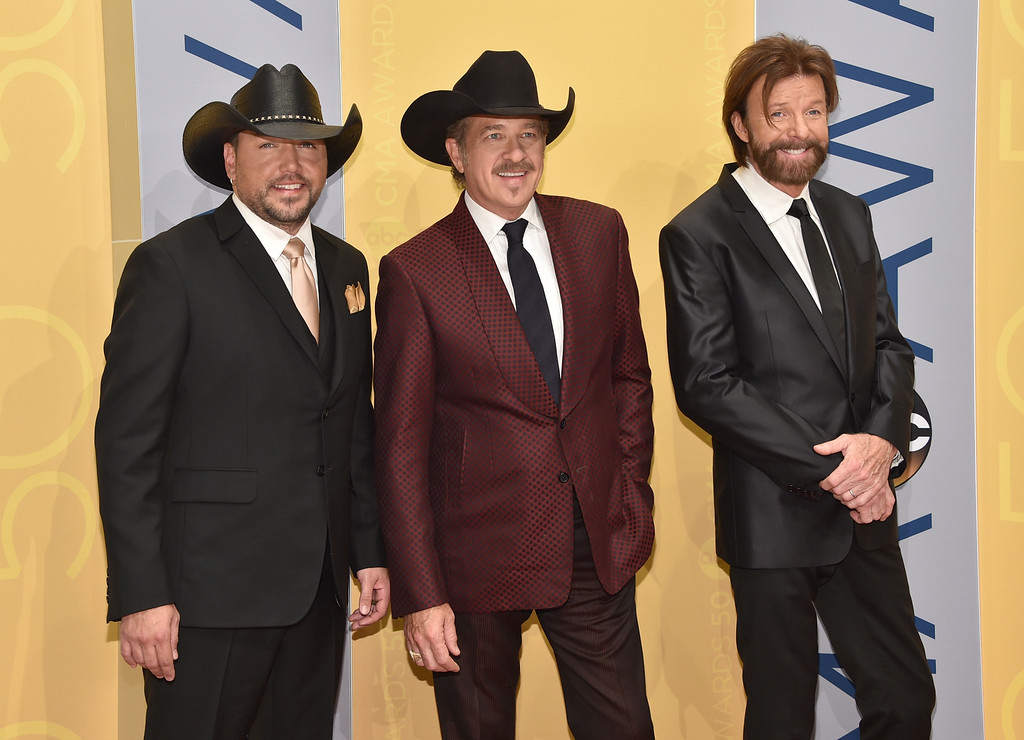 . Jason Aldean, from left, Kix Brooks and Ronnie Dunn, of Brooks & Dunn, arrive at the 50th annual CMA Awards at the Bridgestone Arena on Wednesday, Nov. 2, 2016, in Nashville, Tenn. (Photo by Evan Agostini/Invision/AP)
