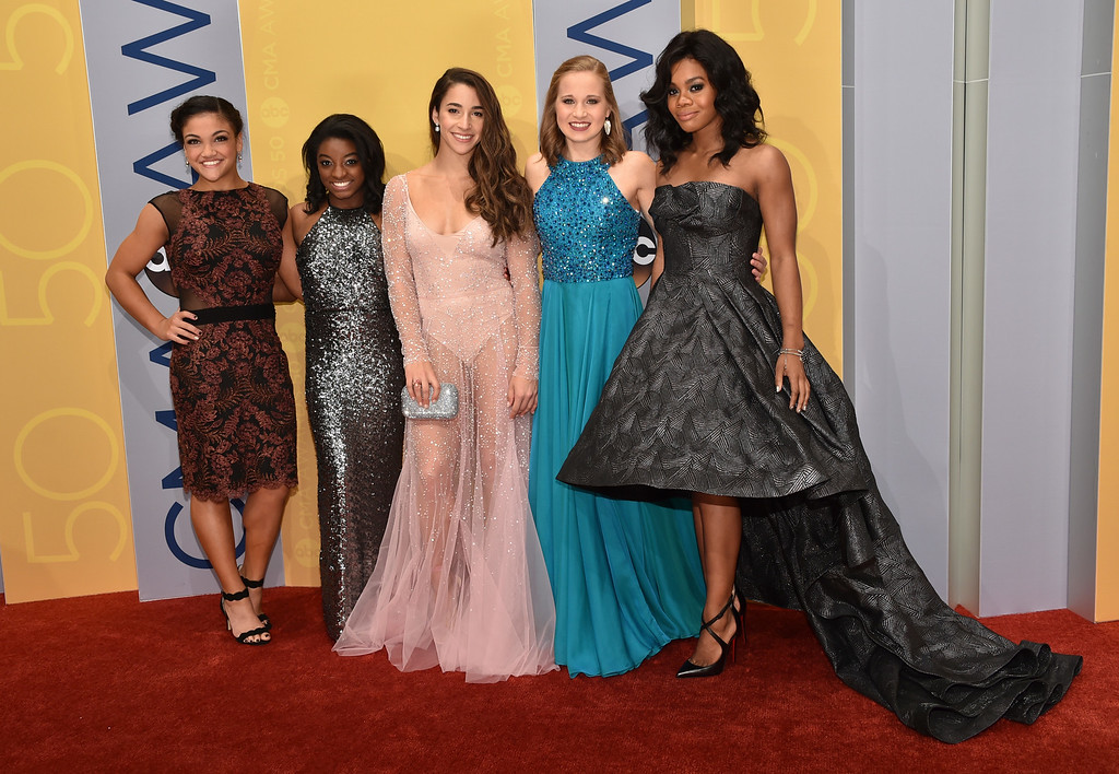 . Olympic gymnasts Laurie Hernandez, from left, Simone Biles, Aly Raisman, Madison Kocian, and Gabby Douglas arrive at the 50th annual CMA Awards at the Bridgestone Arena on Wednesday, Nov. 2, 2016, in Nashville, Tenn. (Photo by Evan Agostini/Invision/AP)