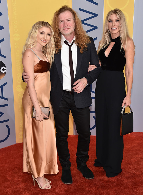 . Electra Mustaine, from left, Dave Mustaine and Pamela Anne Casselberry arrive at the 50th annual CMA Awards at the Bridgestone Arena on Wednesday, Nov. 2, 2016, in Nashville, Tenn. (Photo by Evan Agostini/Invision/AP)