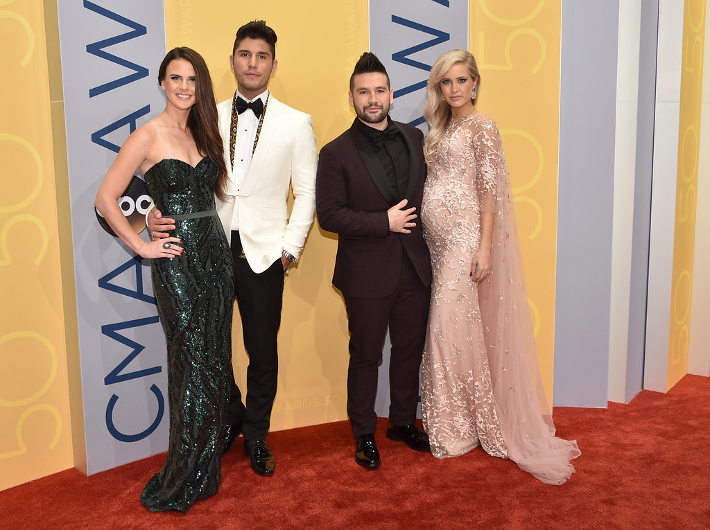 . Abby Law, from left, Dan Smyers, Shay Mooney, of the musical group Dan + Shay, and Hannah Billingsley arrive at the 50th annual CMA Awards at the Bridgestone Arena on Wednesday, Nov. 2, 2016, in Nashville, Tenn. (Photo by Evan Agostini/Invision/AP)