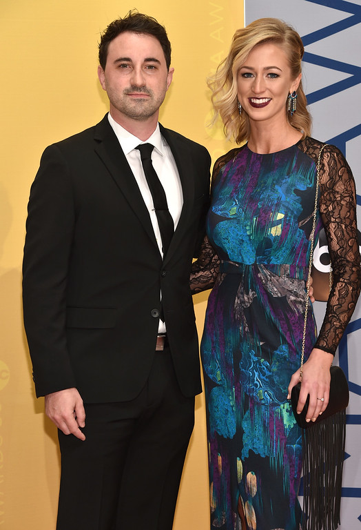 . Derek Wells, left, and Emily Eshuis arrive at the 50th annual CMA Awards at the Bridgestone Arena on Wednesday, Nov. 2, 2016, in Nashville, Tenn. (Photo by Evan Agostini/Invision/AP)