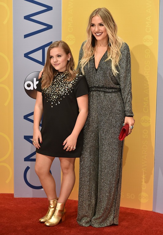 . Maisy Stella, left, and Lennon Stella, of Lennon & Maisy, arrive at the 50th annual CMA Awards at the Bridgestone Arena on Wednesday, Nov. 2, 2016, in Nashville, Tenn. (Photo by Evan Agostini/Invision/AP)