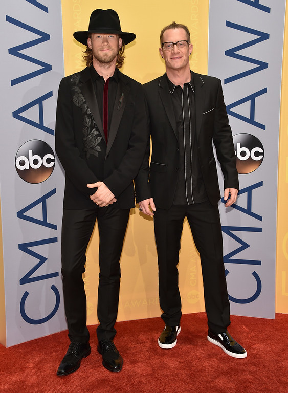 . Brian Kelley, left, and Tyler Hubbard arrive at the 50th annual CMA Awards at the Bridgestone Arena on Wednesday, Nov. 2, 2016, in Nashville, Tenn. (Photo by Evan Agostini/Invision/AP)