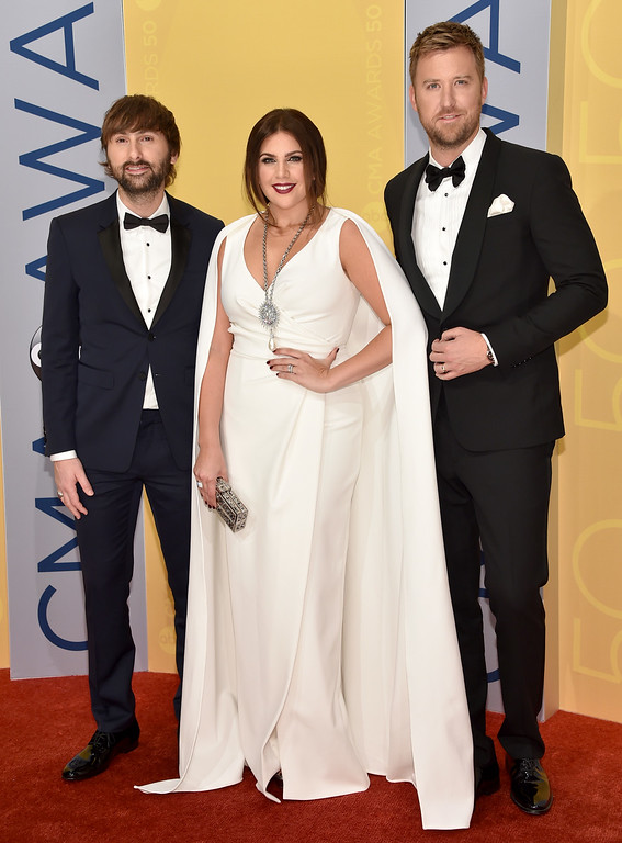 . Dave Haywood, from left, Hillary Scott and Charles Kelley, of Lady Antebellum, arrive at the 50th annual CMA Awards at the Bridgestone Arena on Wednesday, Nov. 2, 2016, in Nashville, Tenn. (Photo by Evan Agostini/Invision/AP)