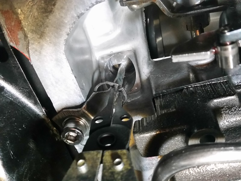 "This is the ""easy way"" to pull the boost valve when the transmission is in the car (or anytime, for that matter) by making a ""holding bracket"" out of some 16 ga sheetmetal. Works like a champ to relieve the pressure on the snap ring to get it out and also to reinstall the snap ring."