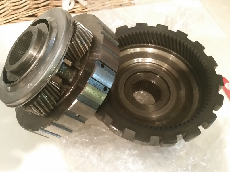"""New rear planetary gear set with """"oil slinger"""" ring to improve oiling of the planetary. The old one did not have that feature."""