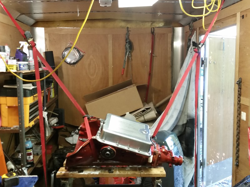 "Listen, ya'll, this thing weighs 155 pounds, and I'm gettin' old, so I decided to apply my ""rigging skills"" to avoid arm/shoulder/back injury to get this thing off the work bench and into the ""garage"". This is the first phase of getting it to the floor/transmission jack."