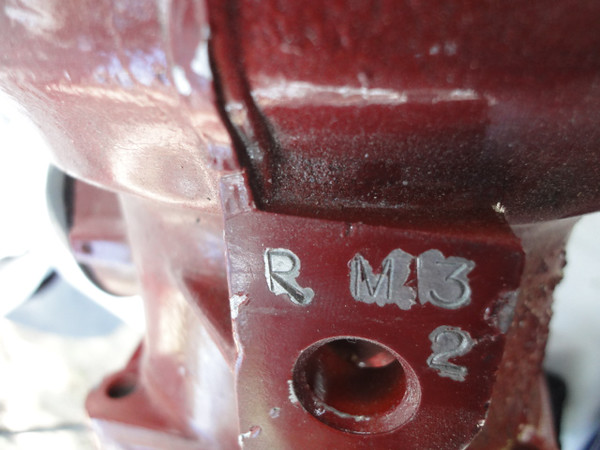 """Update 2/23/2015 - I ran across an Ebay ad that had a picture of a 700R4 transmission  painted the same color as the one I bought. The ad was placed by """"Mad Dog Transmissions"""",  so I called them and gave the lady who answered the phone these codes stamped on the top rear of the transmission. She confirmed that these codes mean: """"RM"""" the initials of the person who built it, """"L3"""" is Level 3 (650 HP rated), and the """"2"""" means it has a number 2 shift kit already installed. Not to bad mouth MAD DOG TRANSMISSIONS, but you will see in later photos where I replaced the cast aluminum pressure plates with steel ones, which is THE ONLY way to go for a high performance transmission, maybe... ahahah. Additionally, it seemed that just about all the parts in the """"guts"""" were stock parts, but then again, I'm no expert at this point, but I might be by the time I get done with this thing...ahaha"""