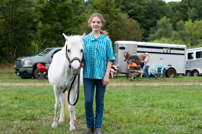 """Daniela Rathke from Alstead, NH stands with her horse, """"April"""" at the Guilford Fair on Sunday; KELLY FLETCHER, REFORMER CORRESPONDENT"""