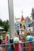 a fair goer demonstrates his strength at the Guilford Fair September 1; KELLY FLETCHER, REFORMER CORRESPONDENT