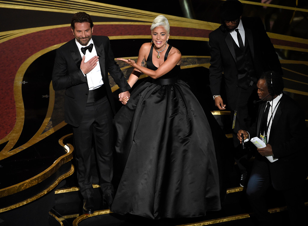 ". Bradley Cooper, left, and Lady Gaga react to the audience after a performance of ""Shallow\"" from \'A Star is Born\' at the Oscars on Sunday, Feb. 24, 2019, at the Dolby Theatre in Los Angeles. (Photo by Chris Pizzello/Invision/AP)"
