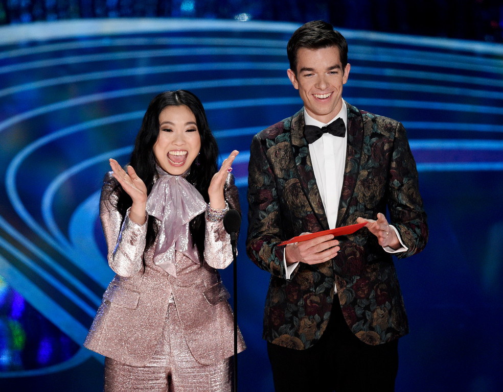 . Awkwafina, left, and John Mulaney present the award for best animated short at the Oscars on Sunday, Feb. 24, 2019, at the Dolby Theatre in Los Angeles. (Photo by Chris Pizzello/Invision/AP)