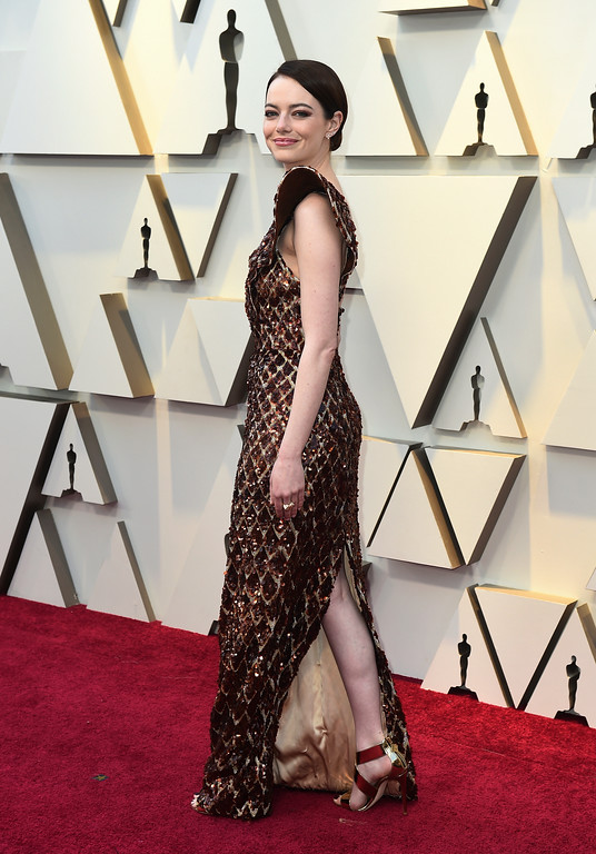 . Emma Stone arrives at the Oscars on Sunday, Feb. 24, 2019, at the Dolby Theatre in Los Angeles. (Photo by Jordan Strauss/Invision/AP)