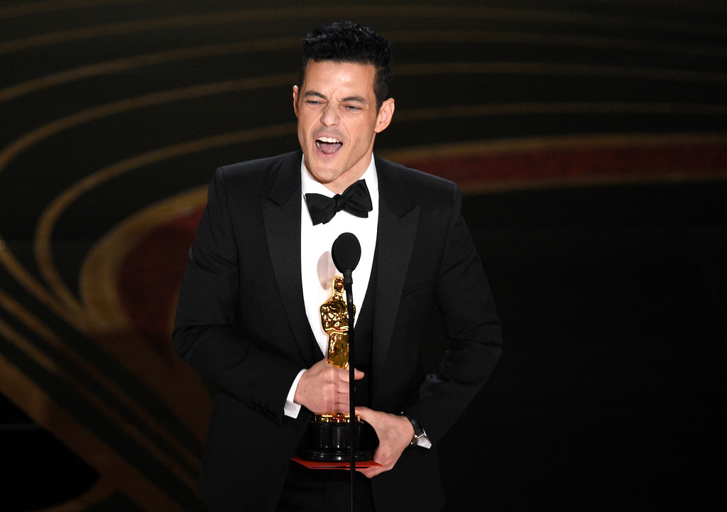 ". Rami Malek accepts the award for best performance by an actor in a leading role for ""Bohemian Rhapsody\"" at the Oscars on Sunday, Feb. 24, 2019, at the Dolby Theatre in Los Angeles. (Photo by Chris Pizzello/Invision/AP)"