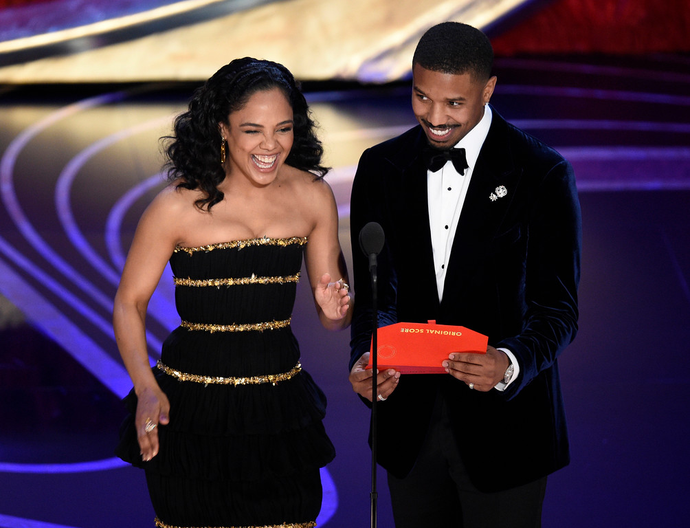 . Tessa Thompson, left, and Michael B. Jordan present the award for best original score at the Oscars on Sunday, Feb. 24, 2019, at the Dolby Theatre in Los Angeles. (Photo by Chris Pizzello/Invision/AP)