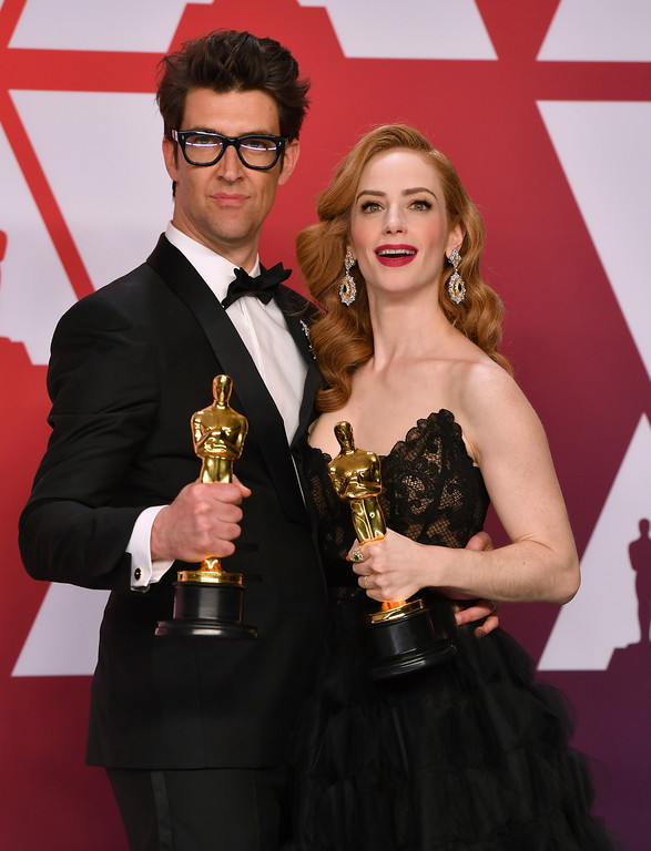 ". Guy Nattiv, left, and Jaime Ray Newman pose with award for best live action short film for ""Skin\"" in the press room at the Oscars on Sunday, Feb. 24, 2019, at the Dolby Theatre in Los Angeles. (Photo by Jordan Strauss/Invision/AP)"
