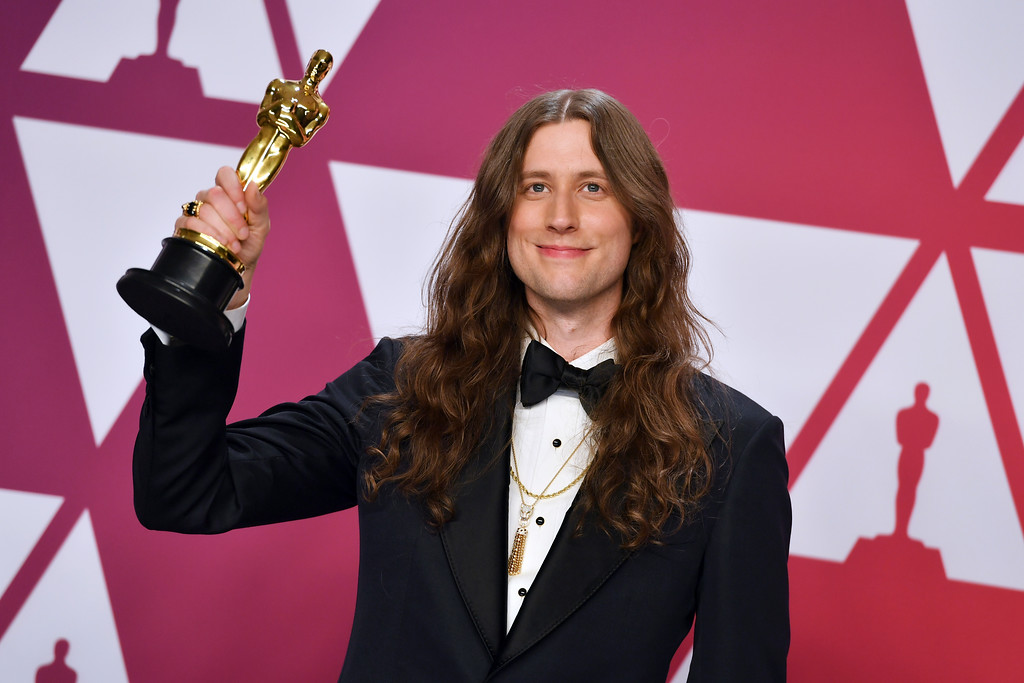 ". Ludwig Goransson poses with the award for best original score for ""Black Panther\"" in the press room at the Oscars on Sunday, Feb. 24, 2019, at the Dolby Theatre in Los Angeles. (Photo by Jordan Strauss/Invision/AP)"