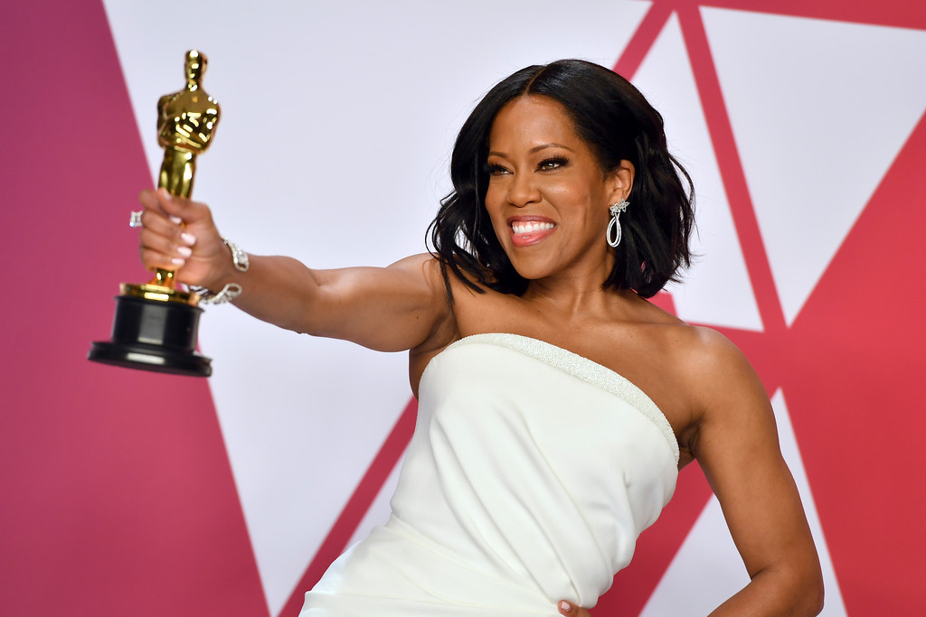 ". Regina King poses with the award for best performance by an actress in a supporting role for ""If Beale Street Could Talk\"" in the press room at the Oscars on Sunday, Feb. 24, 2019, at the Dolby Theatre in Los Angeles. (Photo by Jordan Strauss/Invision/AP)"