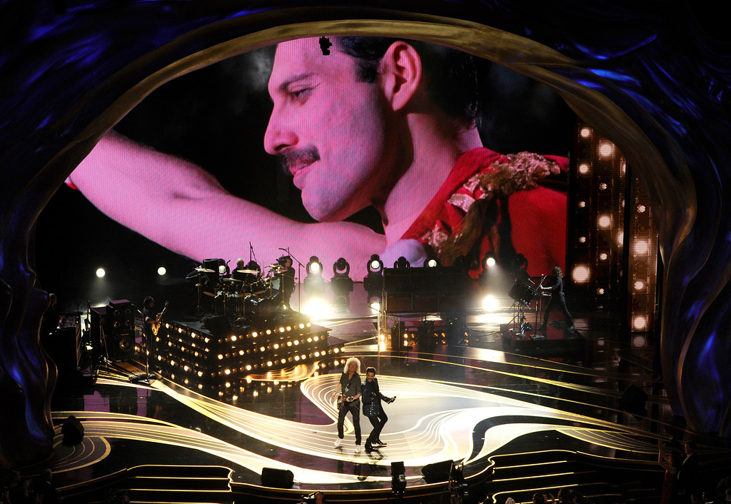 . An image of Freddie Mercury appears on screen as Brian May, left, and Adam Lambert of Queen perform at the Oscars on Sunday, Feb. 24, 2019, at the Dolby Theatre in Los Angeles. (Photo by Chris Pizzello/Invision/AP)