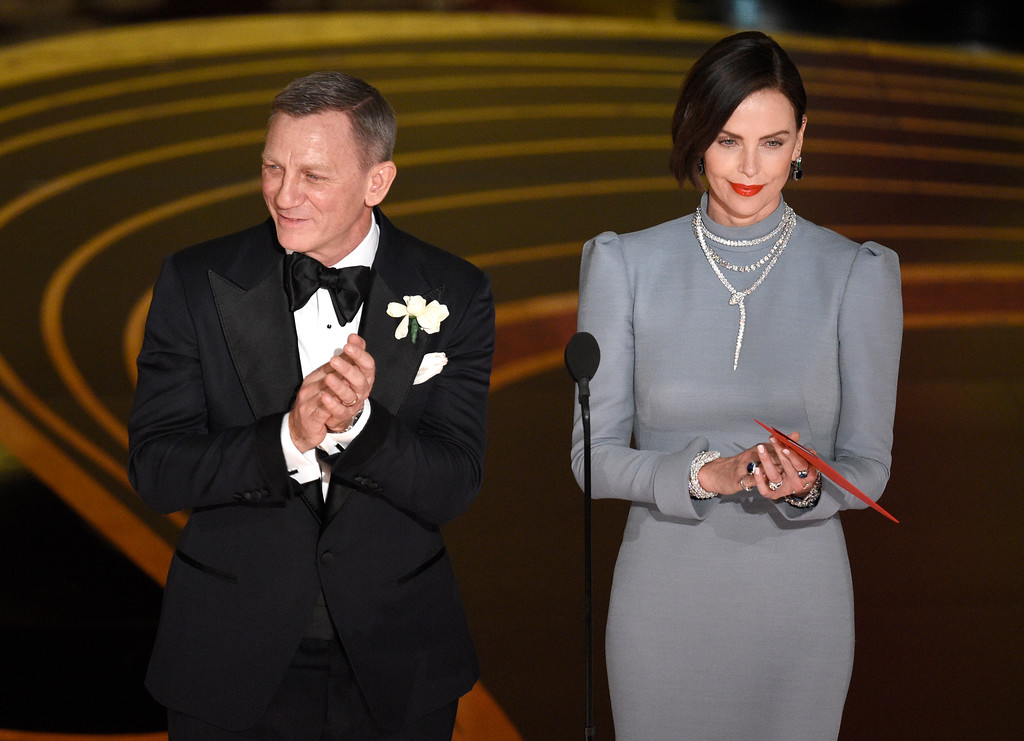 . Daniel Craig, left, and Charlize Theron present the award for best performance by an actor in a supporting role at the Oscars on Sunday, Feb. 24, 2019, at the Dolby Theatre in Los Angeles. (Photo by Chris Pizzello/Invision/AP)