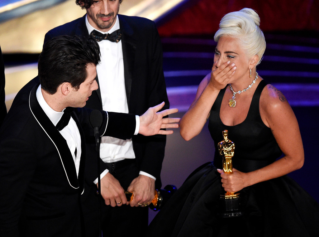 ". Mark Ronson, from left, Anthony Rossomando and Lady Gaga accept the award for best original song for ""Shallow\"" from \""A Star Is Born\"" at the Oscars on Sunday, Feb. 24, 2019, at the Dolby Theatre in Los Angeles. (Photo by Chris Pizzello/Invision/AP)"