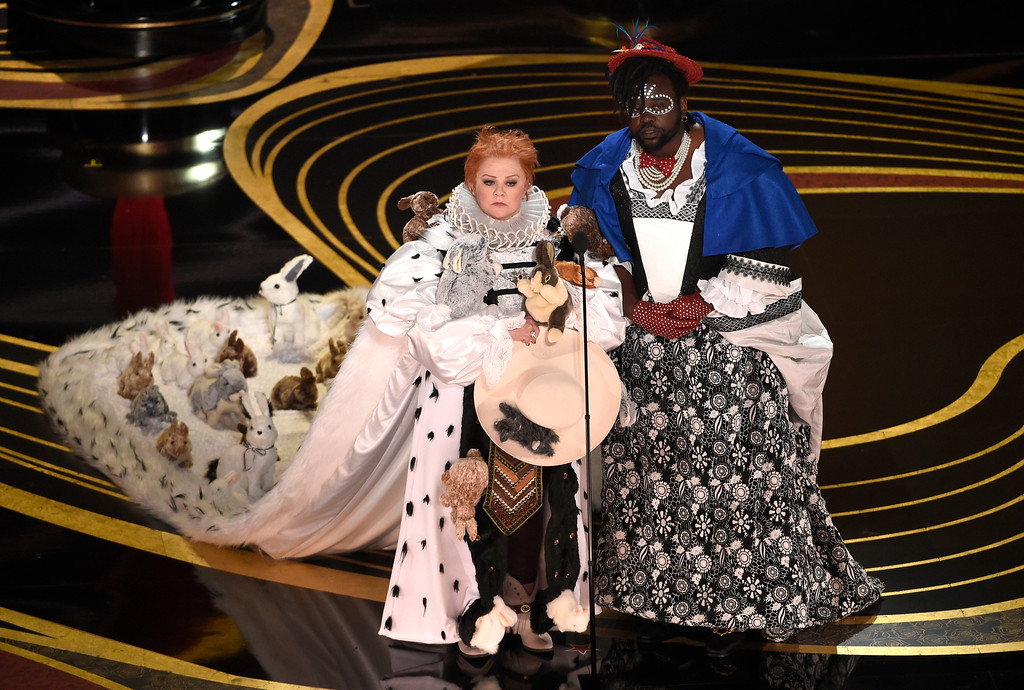 . Melissa McCarthy, left, and Brian Tyree Henry present the award for best costume design at the Oscars on Sunday, Feb. 24, 2019, at the Dolby Theatre in Los Angeles. (Photo by Chris Pizzello/Invision/AP)