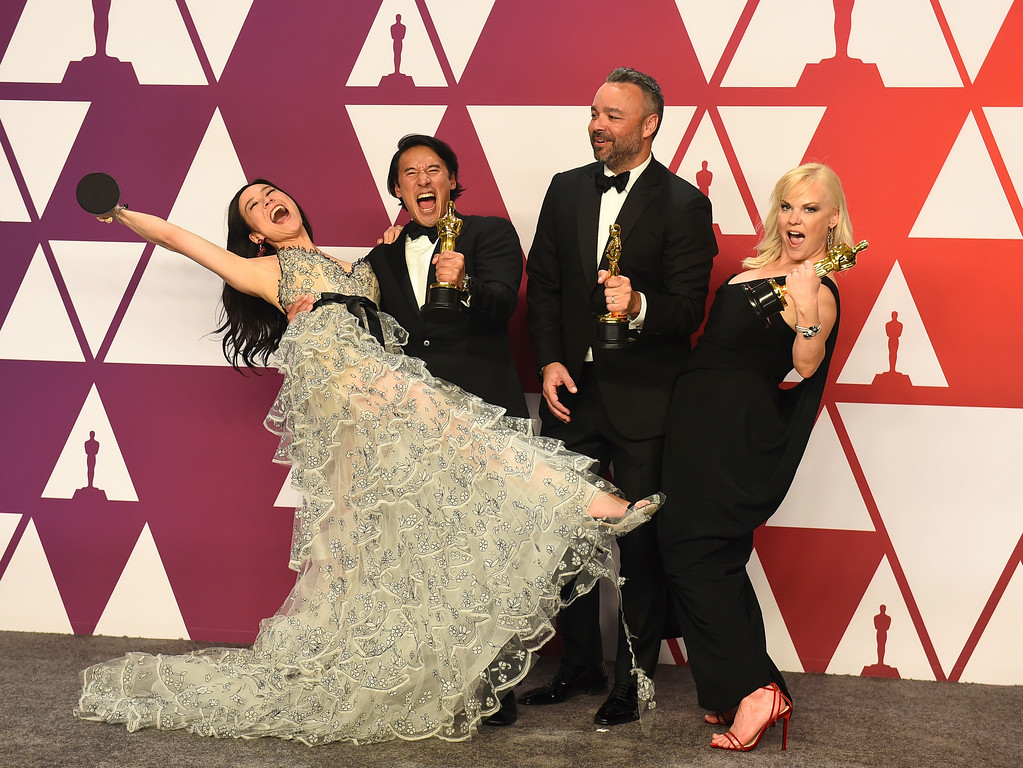 . Elizabeth Chai Vasarhelyi, from left, Jimmy Chin, Evan Hayes, and Shannon Dill pose in the press room with the award for best documentary feature for �Free Solo�  at the Oscars on Sunday, Feb. 24, 2019, at the Dolby Theatre in Los Angeles. (Photo by Jordan Strauss/Invision/AP)