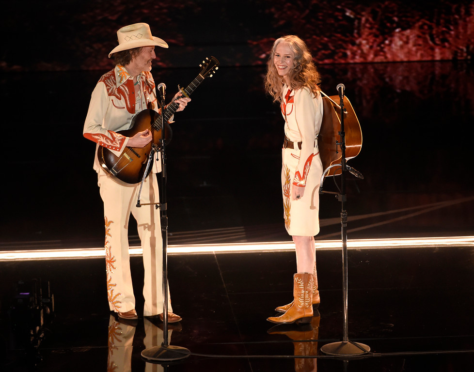 ". David Rawlings, left, and Gillian Welch perform ""When A Cowboy Trades His Spurs For Wings\"" from the film \""The Ballad of Buster Scruggs\"" at the Oscars on Sunday, Feb. 24, 2019, at the Dolby Theatre in Los Angeles. (Photo by Chris Pizzello/Invision/AP)"