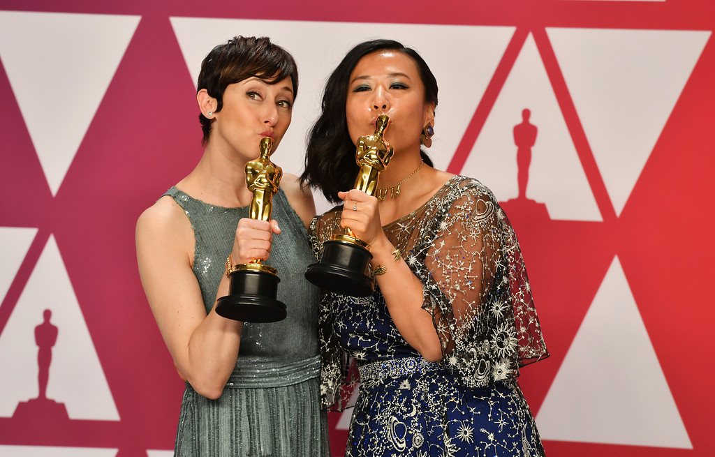 ". Becky Neiman-Cobb, left, and Domee Shi pose with the award for best animated short for ""Bao\"" in the press room at the Oscars on Sunday, Feb. 24, 2019, at the Dolby Theatre in Los Angeles. (Photo by Jordan Strauss/Invision/AP)"