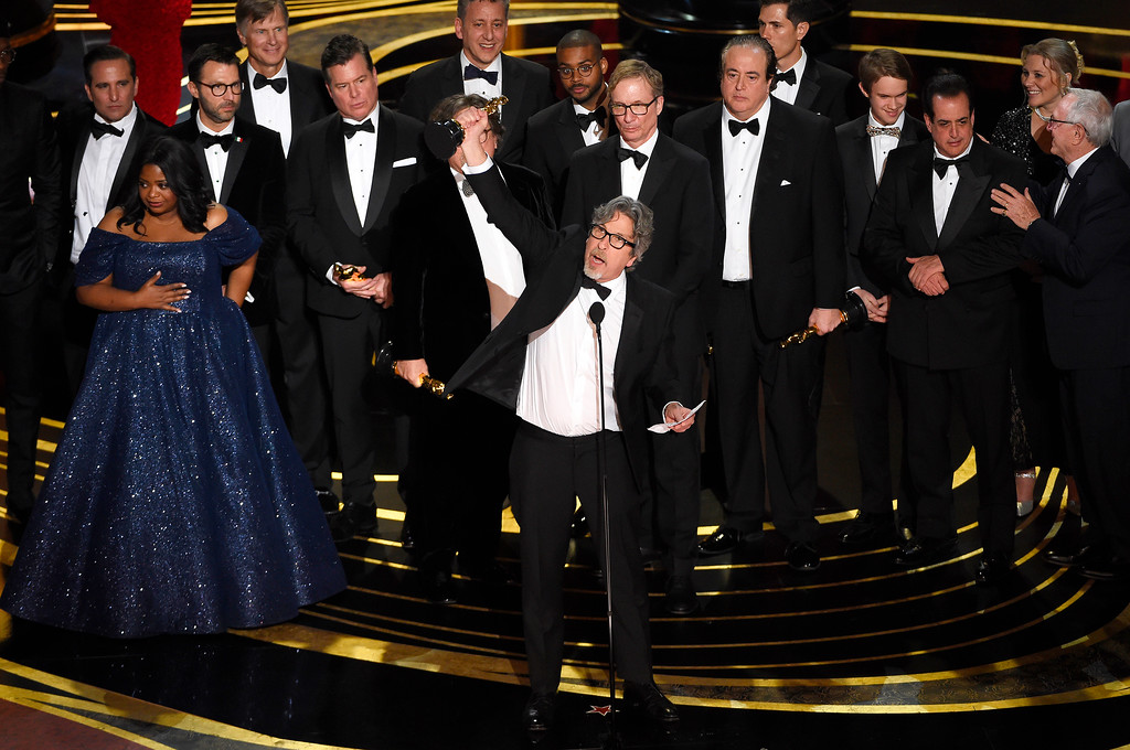 ". Peter Farrelly, center, and the cast and crew of ""Green Book\"" accept the award for best picture at the Oscars on Sunday, Feb. 24, 2019, at the Dolby Theatre in Los Angeles. (Photo by Chris Pizzello/Invision/AP)"