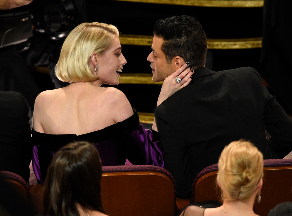 ". Lucy Boynton, left, congratulates Rami Malek, winner of the award for best performance by an actor in a leading role for ""Bohemian Rhapsody\"" at the Oscars on Sunday, Feb. 24, 2019, at the Dolby Theatre in Los Angeles. (Photo by Chris Pizzello/Invision/AP)"