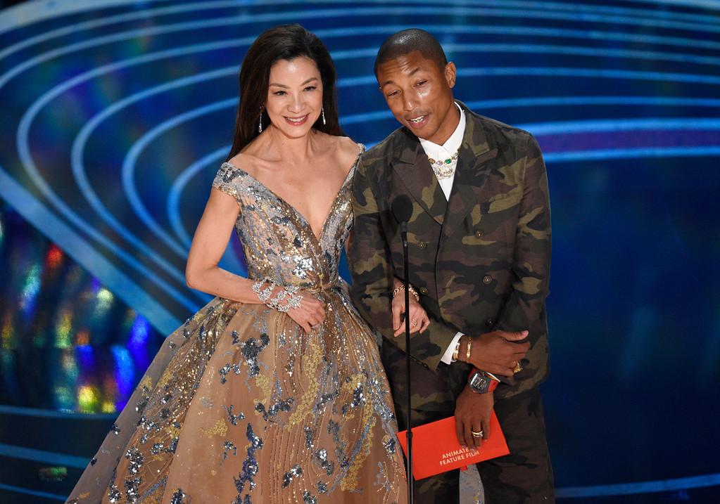 . Michelle Yeoh, left, and Pharrell Williams present the award for best animated feature film at the Oscars on Sunday, Feb. 24, 2019, at the Dolby Theatre in Los Angeles. (Photo by Chris Pizzello/Invision/AP)