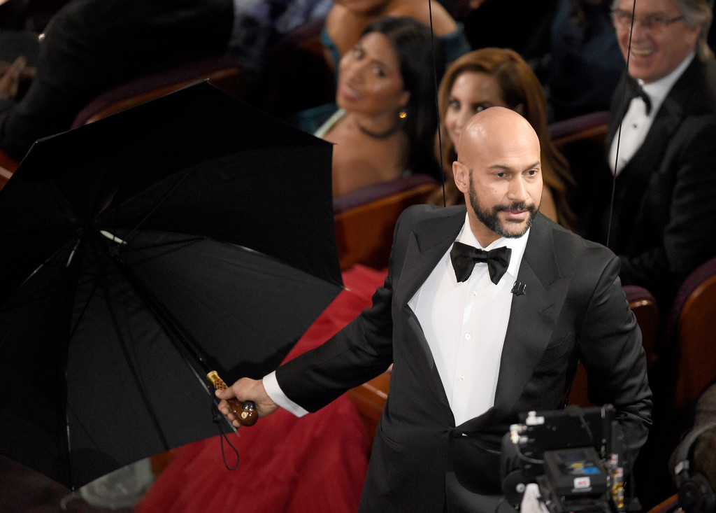 ". Keegan-Michael Key drops down from the ceiling to introduce an original song from ""Mary Poppins Returns\"" at the Oscars on Sunday, Feb. 24, 2019, at the Dolby Theatre in Los Angeles. (Photo by Chris Pizzello/Invision/AP)"