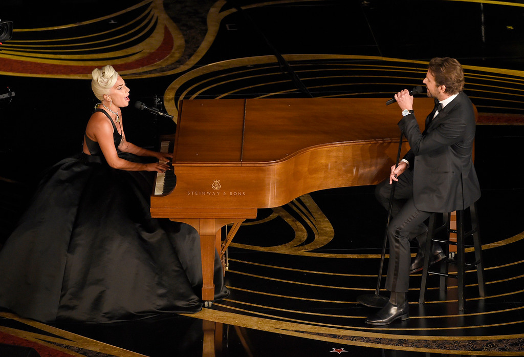 ". Lady Gaga, left, and Bradley Cooper perform ""Shallow\"" from \""A Star is Born\"" at the Oscars on Sunday, Feb. 24, 2019, at the Dolby Theatre in Los Angeles. (Photo by Chris Pizzello/Invision/AP)"