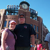 Happy couple in front of Coors Field