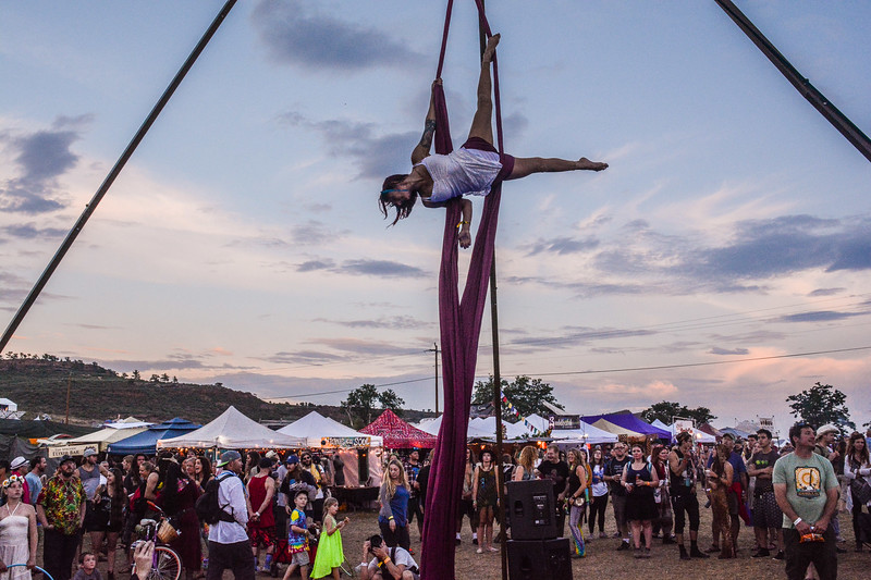 Acrobat Jessical Weil performs ariel tricks for particpats of the 4th Annual ARISE Music Festival, Saturday, August 6, 2016, held on Sunrise Ranch outside of Loveland Colorado.