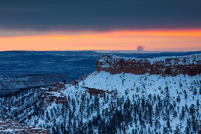 Sunrise in spite of thick clouds at Bryce Canyon's famous Sunrise Point.