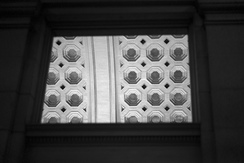 <b>Window to Ceiling</b> - The high ceilings in Union Station, Washington DC, as seen through a hole in the wall.