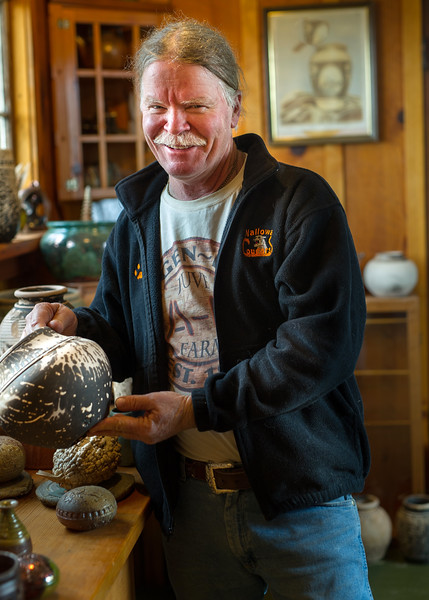 Ceramic artist Ted Juve examines a pot made in the obvara technique. He is a Wallowa Couty native who was born in an 1880's farmhouse near Enterprise, and has been instrumental in establishing  a flourishing arts community in Wallowa County.