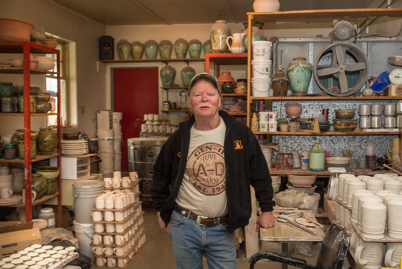 Ceramic artist Ted Juve stands amid his work at his studio on Alder Slope west of Enterprise. Juve's projects include a dinnerware set for the new Minam Lodge, as well as fine arts pieces displayed at the Phinney Gallery in Joseph.
