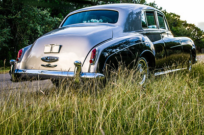 Rear view of 1960 Bentley on a country road.