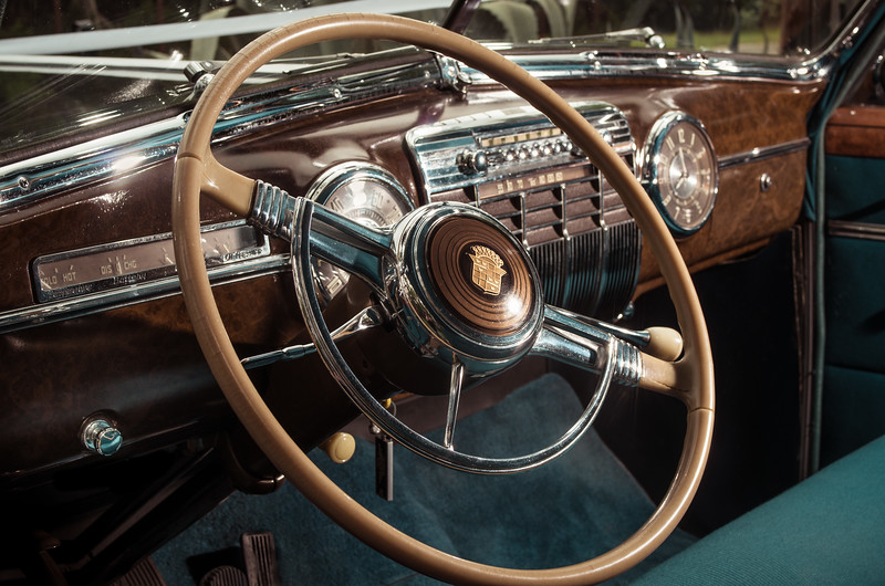 Wooden dashboard and steering wheel of 1941 Cadillac.