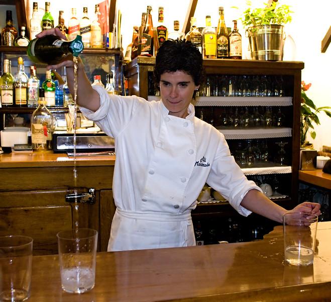 Bartender demonstrating the proper way to pour Txakoli.