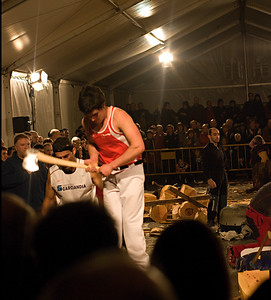 Wood chopping contest in Basque festival.