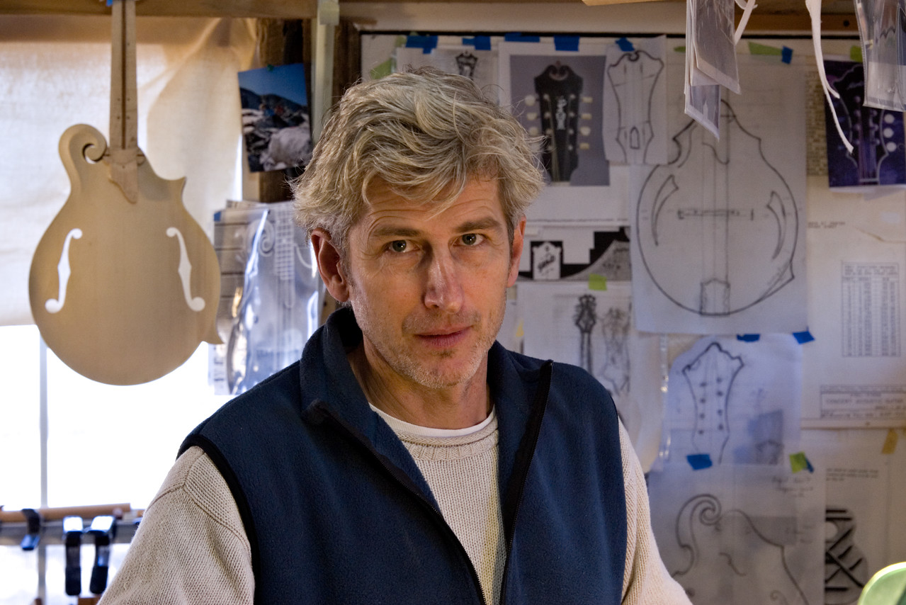 Stefan Passernig, artist, and maker of mandolins in his workshop.