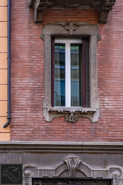 The old and the new. Love the color of the drain pipe as a delineating line.